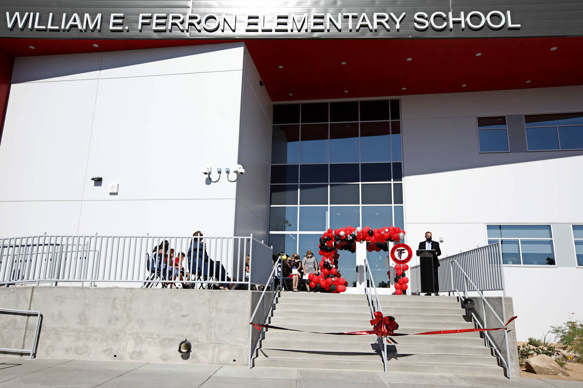 Clark County School District Superintendent Jesus Jara, right, speaks during a ribbon cutting c ...