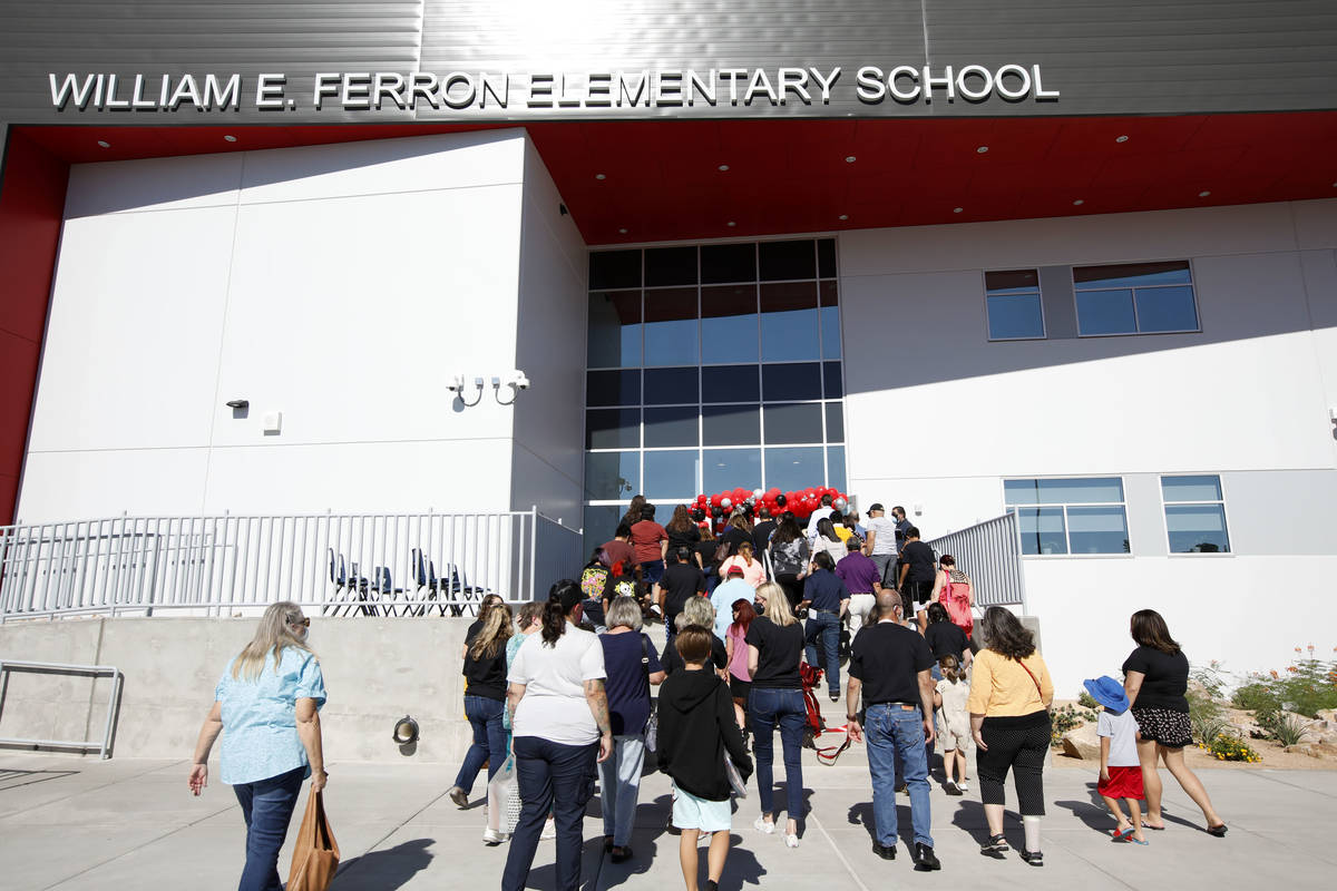 Participants enter the replacement school of Ferron Elementary School after a ribbon cutting c ...