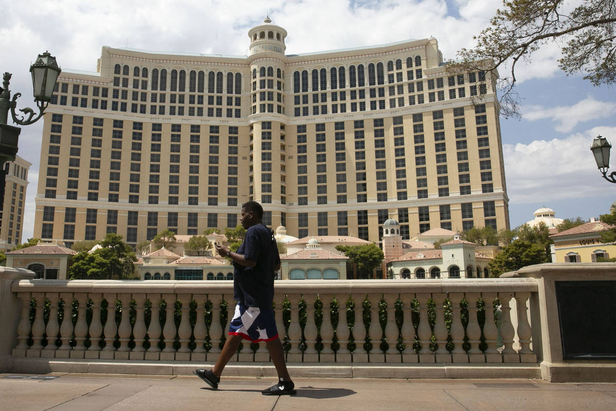Pedestrian walk past the Bellagio on Friday, Aug. 28, 2020, in Las Vegas. (Bizuayehu Tesfaye/L ...