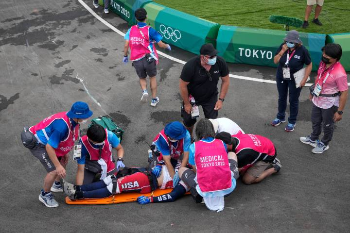 Medics prepare to carry away on a stretcher Connor Fields of the United States after he crashed ...