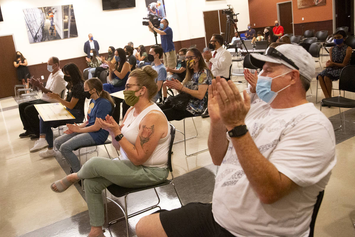 The crowd claps for winners during the announcement of the fifth round of Vax Nevada Days winne ...