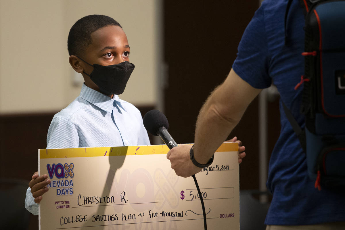 Chrisiton Rogers, 12, who won a $5,000 college savings plan during the announcement of the fift ...