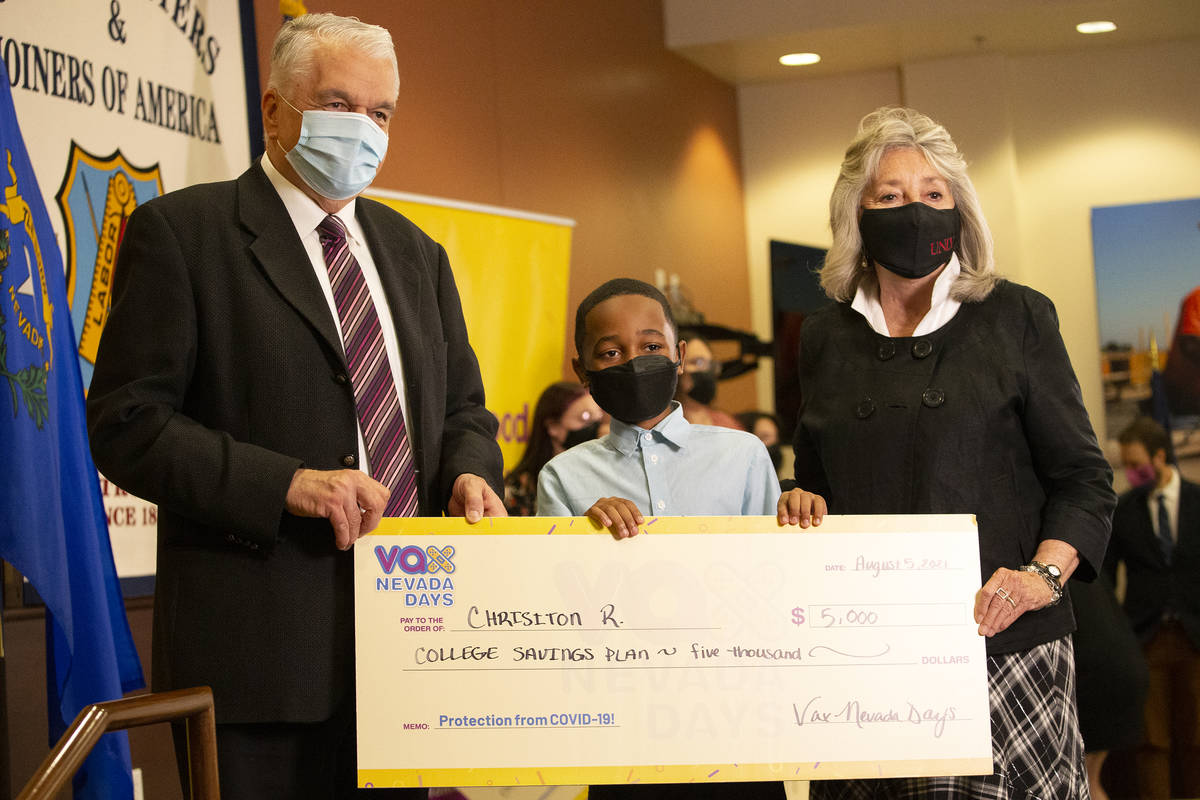 Gov. Steve Sisolak and Congresswoman Dina Titus, D-Nev., pose with Chrisiton Rogers, 12, who wo ...