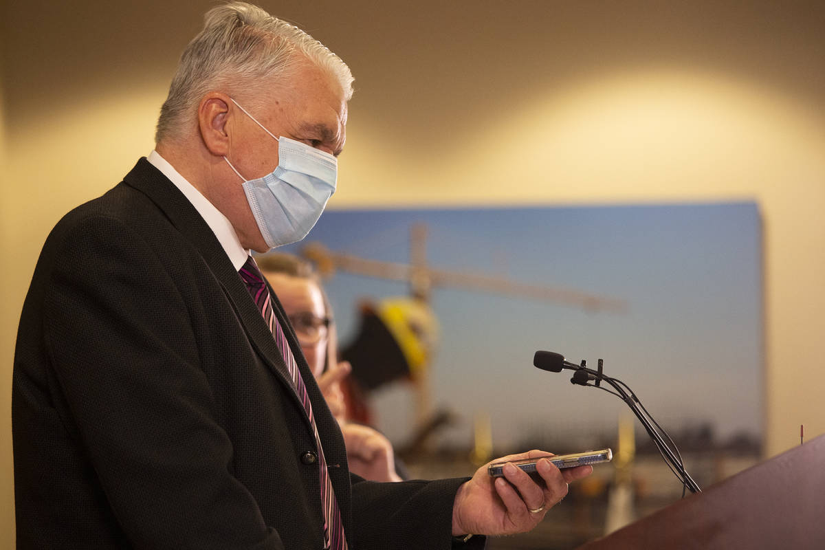 Gov. Steve Sisolak calls the $50,000 cash prize winner, who couldn't make it because she was ho ...