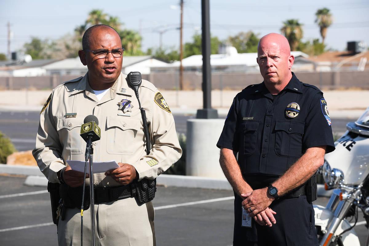 Metropolitan Police Department Capt. Carlos Hank addresses the media next to Bryan Zink, public ...