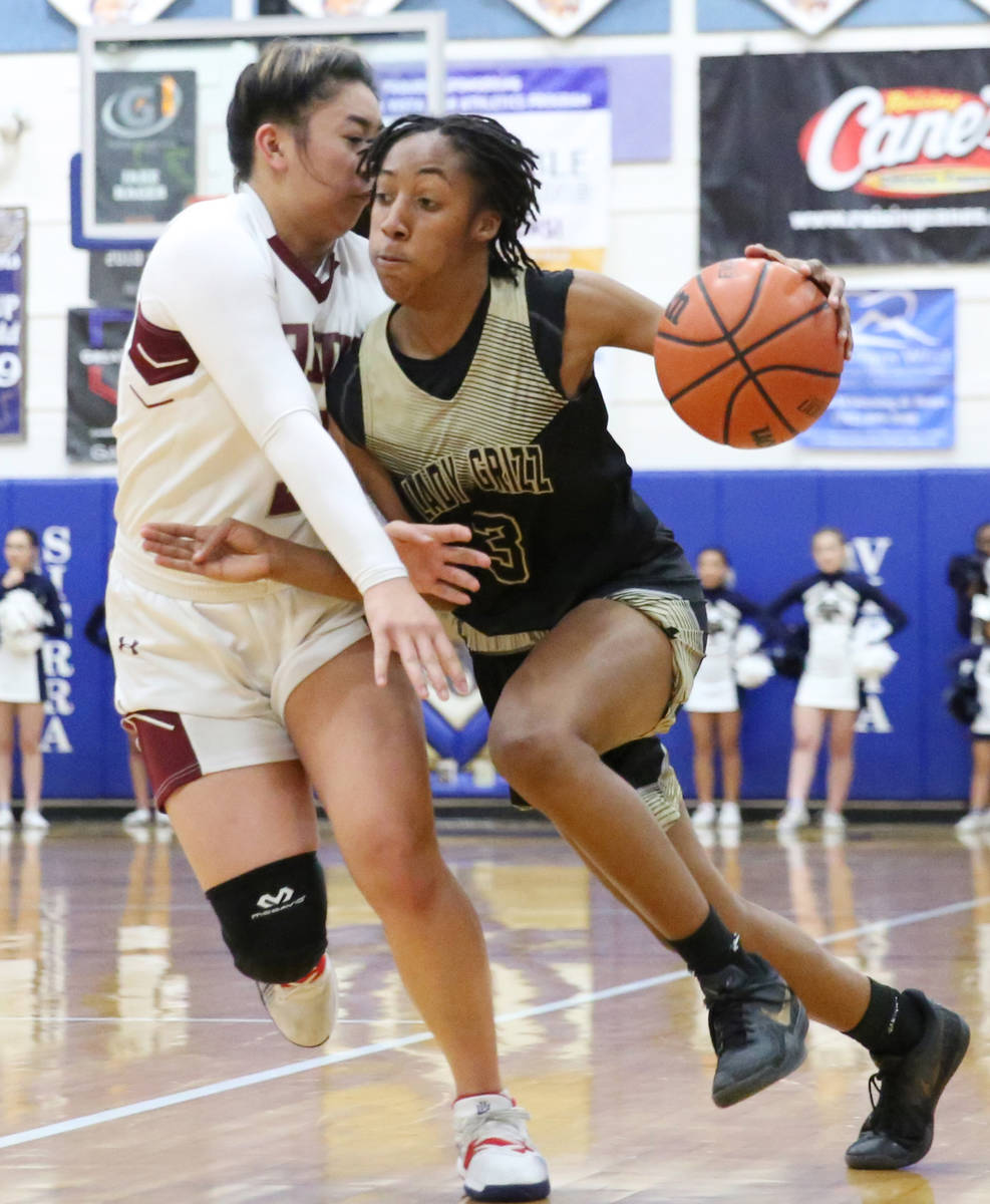 Faith Lutheran's Jalen Tanuvasa, left, defends Spring Valley's Aaliyah Gayles (3) during the se ...