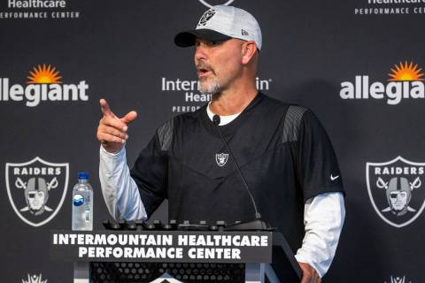 Raiders New Defensive Coordinator Gus Bradley answers a media question during training camp at ...
