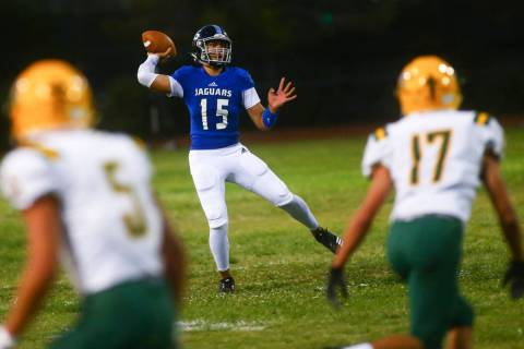 Desert Pines' Rjay Tagataese (15) looks to pass during the first half of a football game agains ...