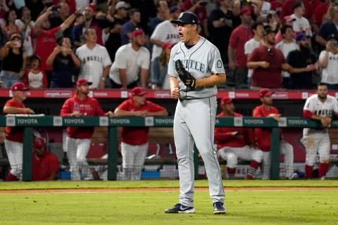 Seattle Mariners relief pitcher Paul Sewald celebrates as the final out is made to end their ba ...