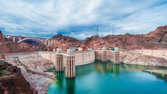 The Hoover Dam is situated on the Colorado River, on the border between Nevada and Arizona. The ...