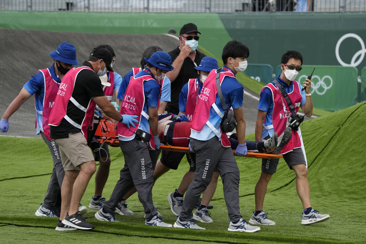 Medics carry away on a stretcher Connor Fields of the United States after he crashed at the fir ...