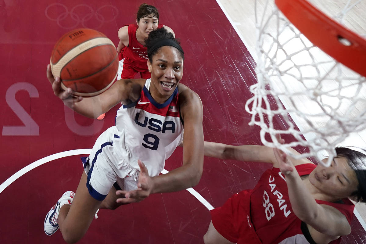 United States's A'Ja Wilson (9) drives past Japan's Himawari Akaho (88) during a women's gold m ...