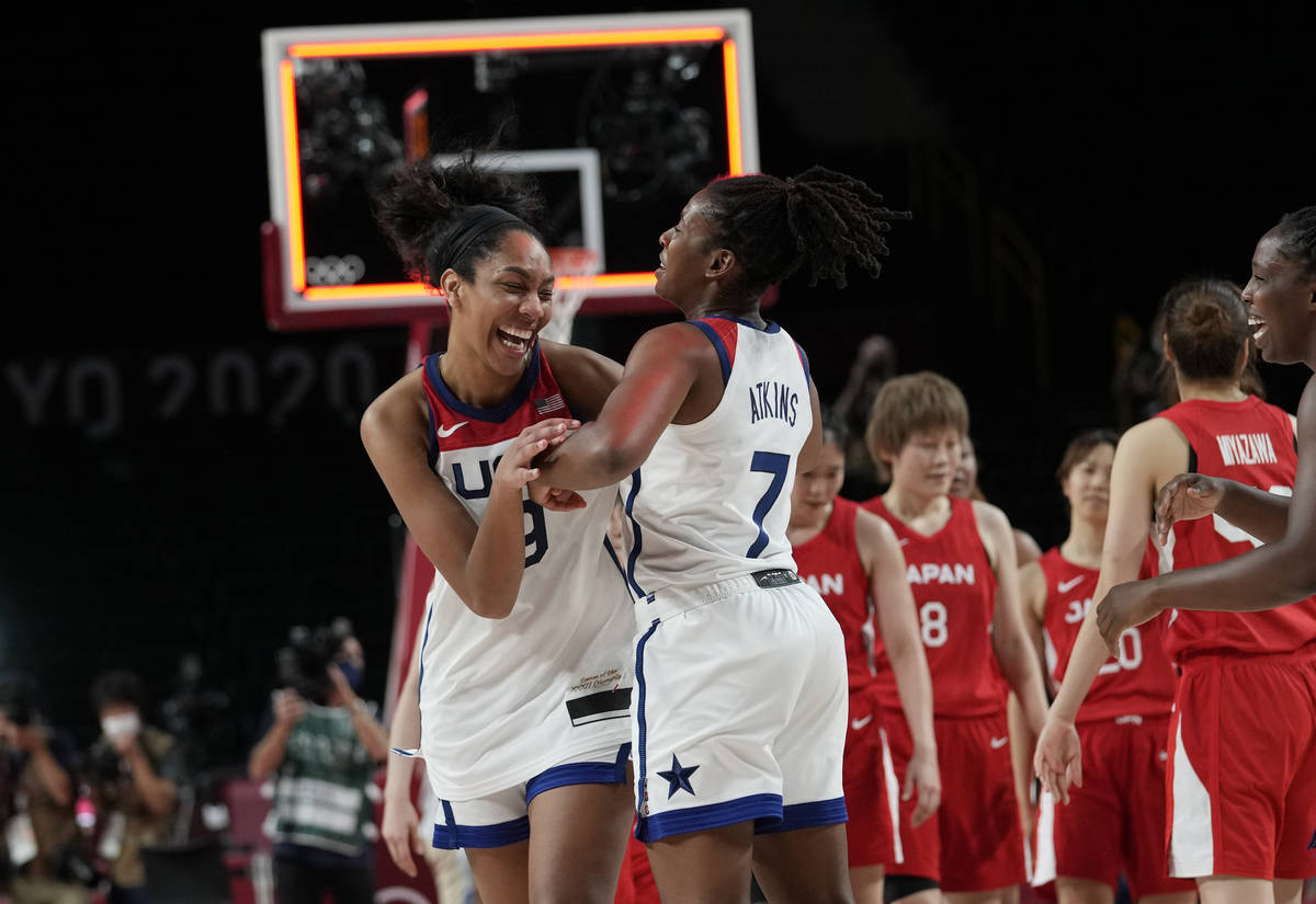 United States's A'Ja Wilson (9) and Ariel Atkins (7) celebrate after their win in the women's b ...