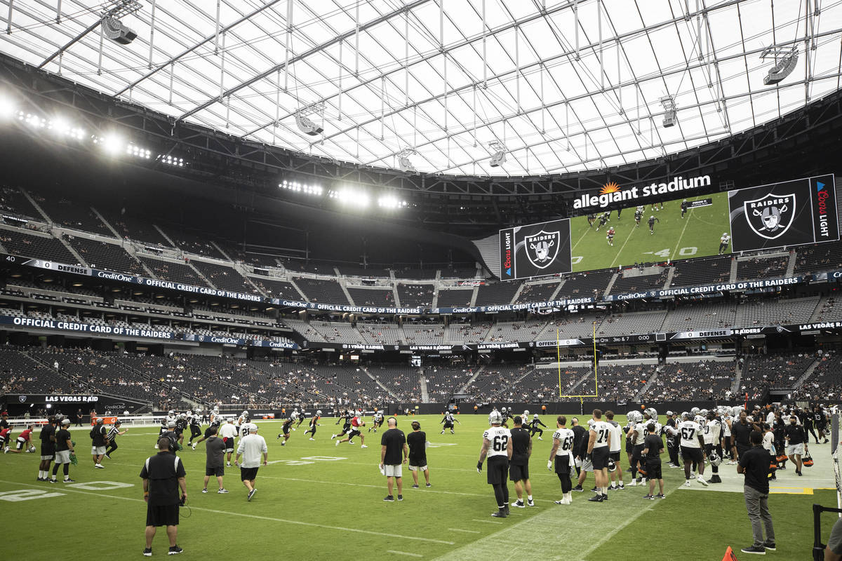 The Raiders scrimmage during a special training camp practice for season ticket holders, team e ...