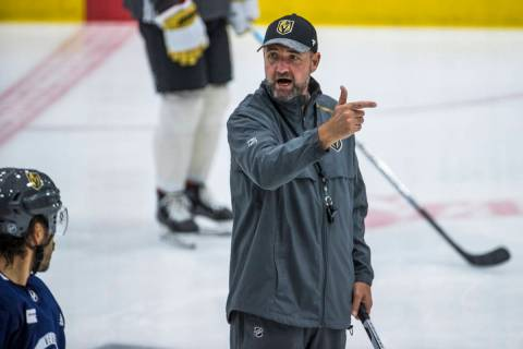 Vegas Golden Knights head coach Peter DeBoer instructs his players while running a new drill du ...