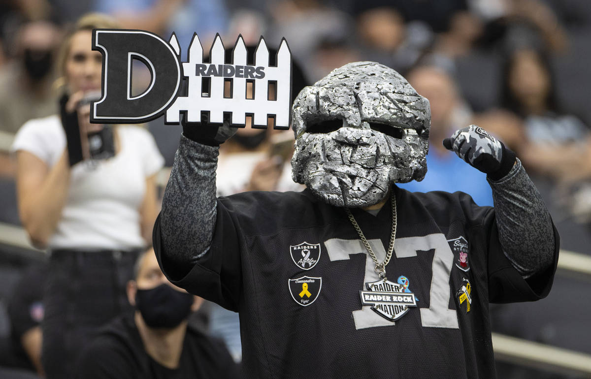 Raider fans take in the action during a special training camp practice for season ticket holder ...