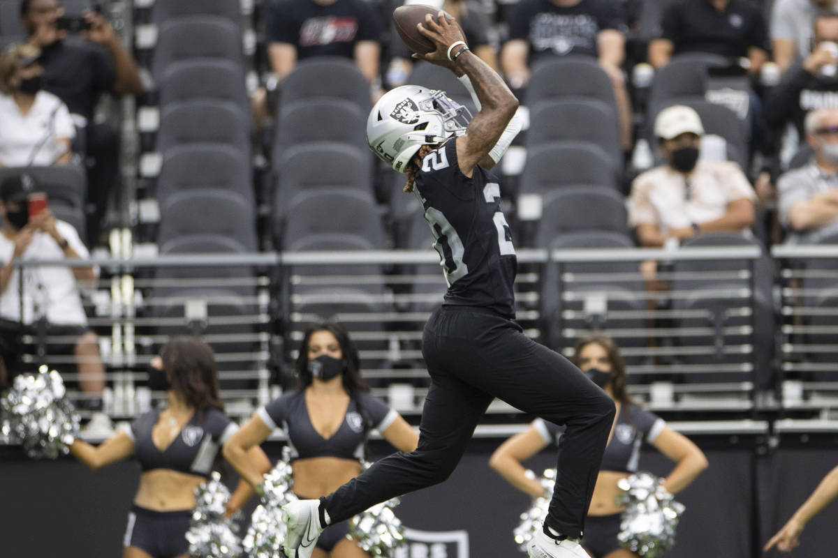 Raiders cornerback Damon Arnette (20) makes a leaping catch during a special training camp prac ...