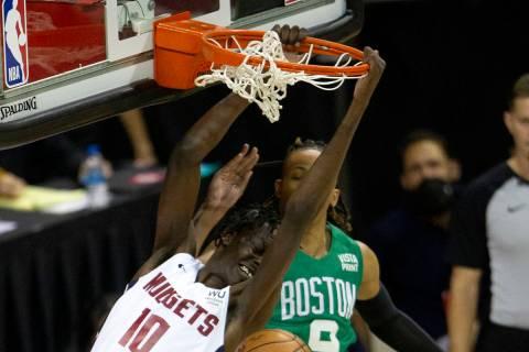 Denver Nuggets center Bol Bol (10) dunks as Boston Celtics guard Romeo Langford (10) jumps to b ...