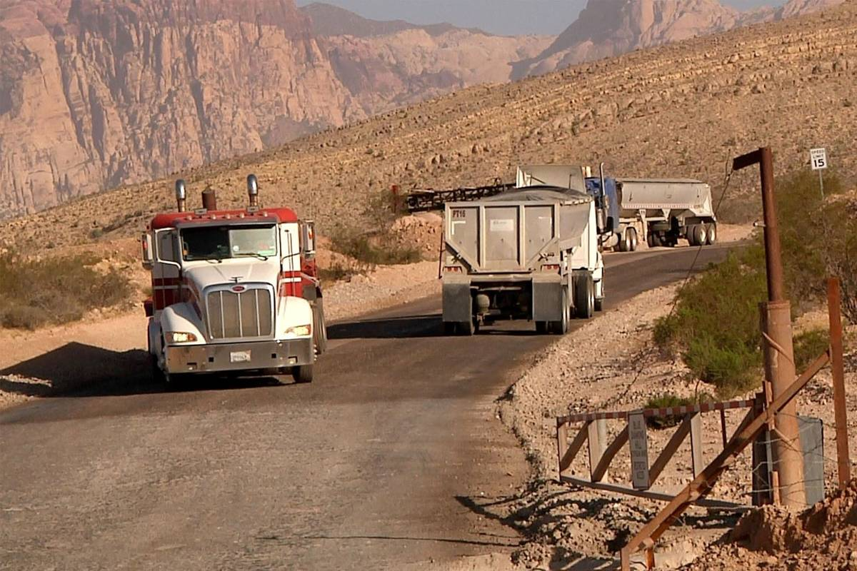 Trucks make their way up and down the road to Blue Diamond Hill Gypsum Mine near Red Rock Canyo ...