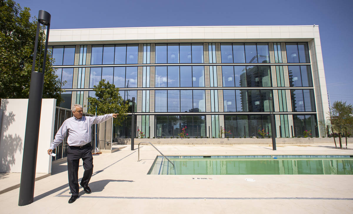 Steve Dennis, general manager of The English Hotel, walks around the pool area during a tour of ...