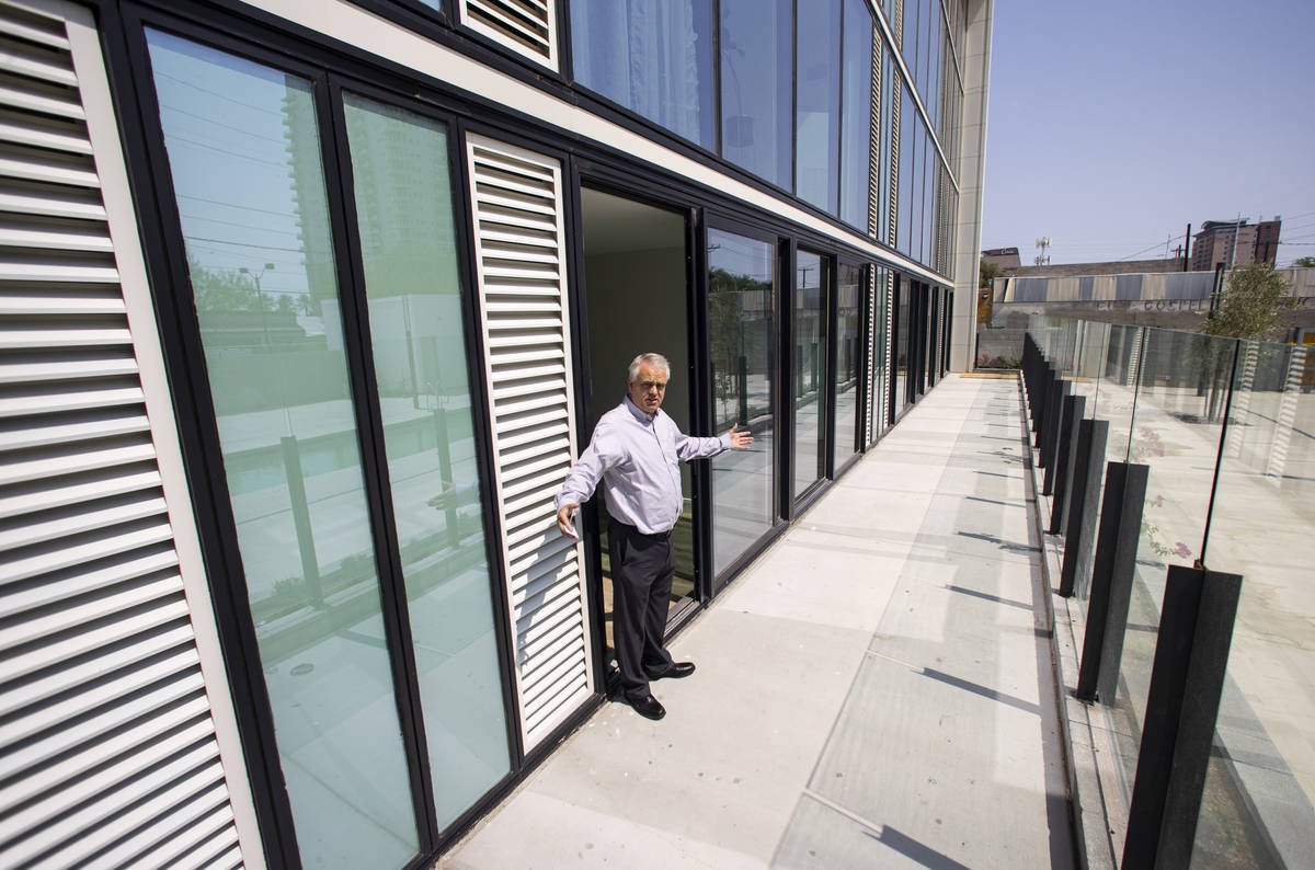 Steve Dennis, general manager of The English Hotel, shows private patio spaces by the pool duri ...