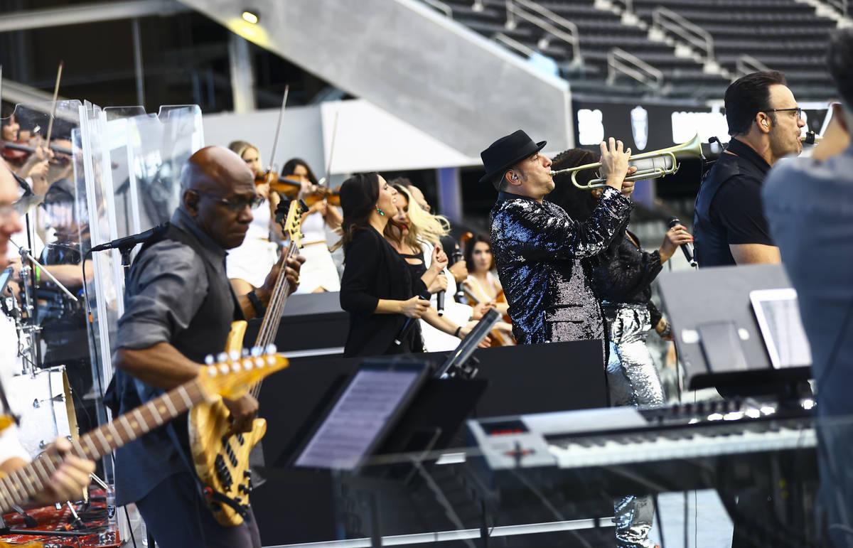 Members of David Perrico's Pop Strings band perform at Allegiant Stadium in Las Vegas on Monday ...