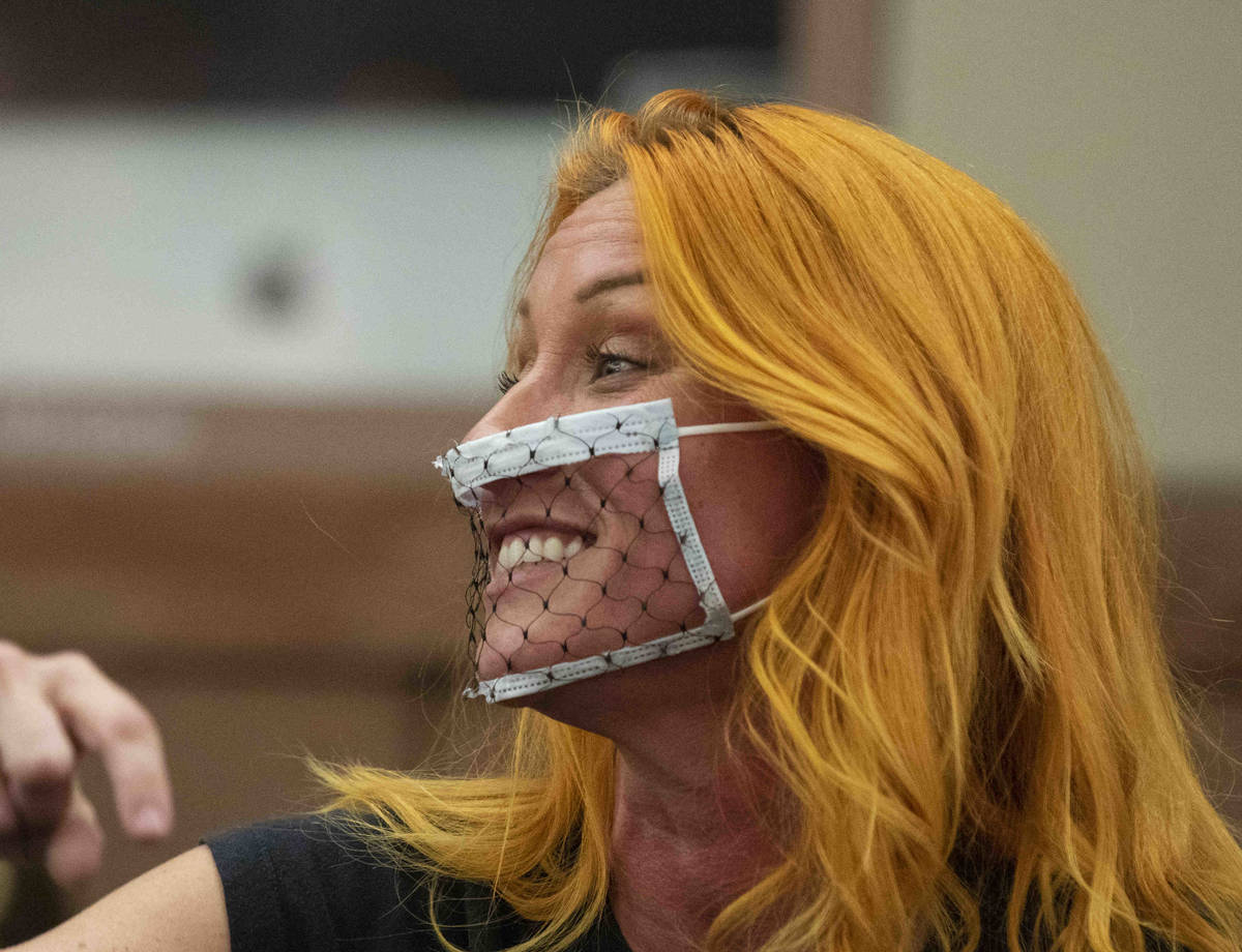 Stephanie Kinsley, protesting against a COVID-19 mandate, reacts during the Clark County Schoo ...