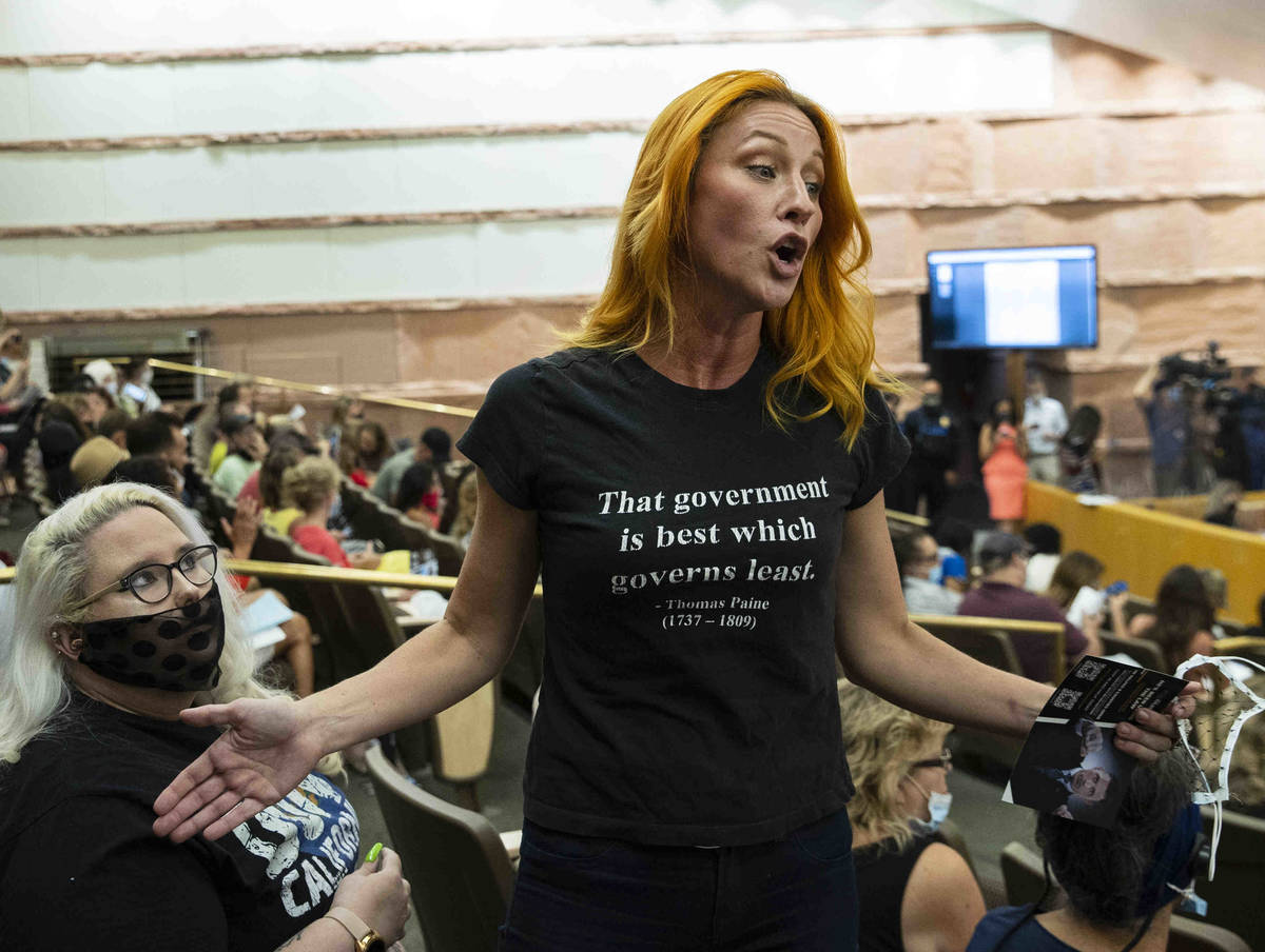 Stephanie Kinsley, protesting against a COVID-19 mandate, reacts during the Clark County School ...