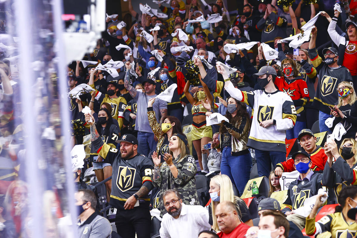 Golden Knights fans cheer at the start of Game 5 of a first-round NHL hockey playoff series aga ...