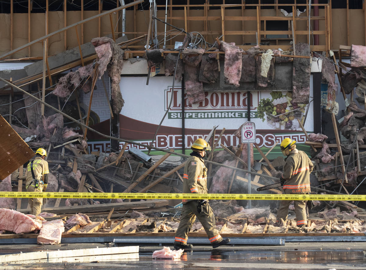 The Clark County firefighters work throw debris after a portion of La Bonita supermarket collap ...