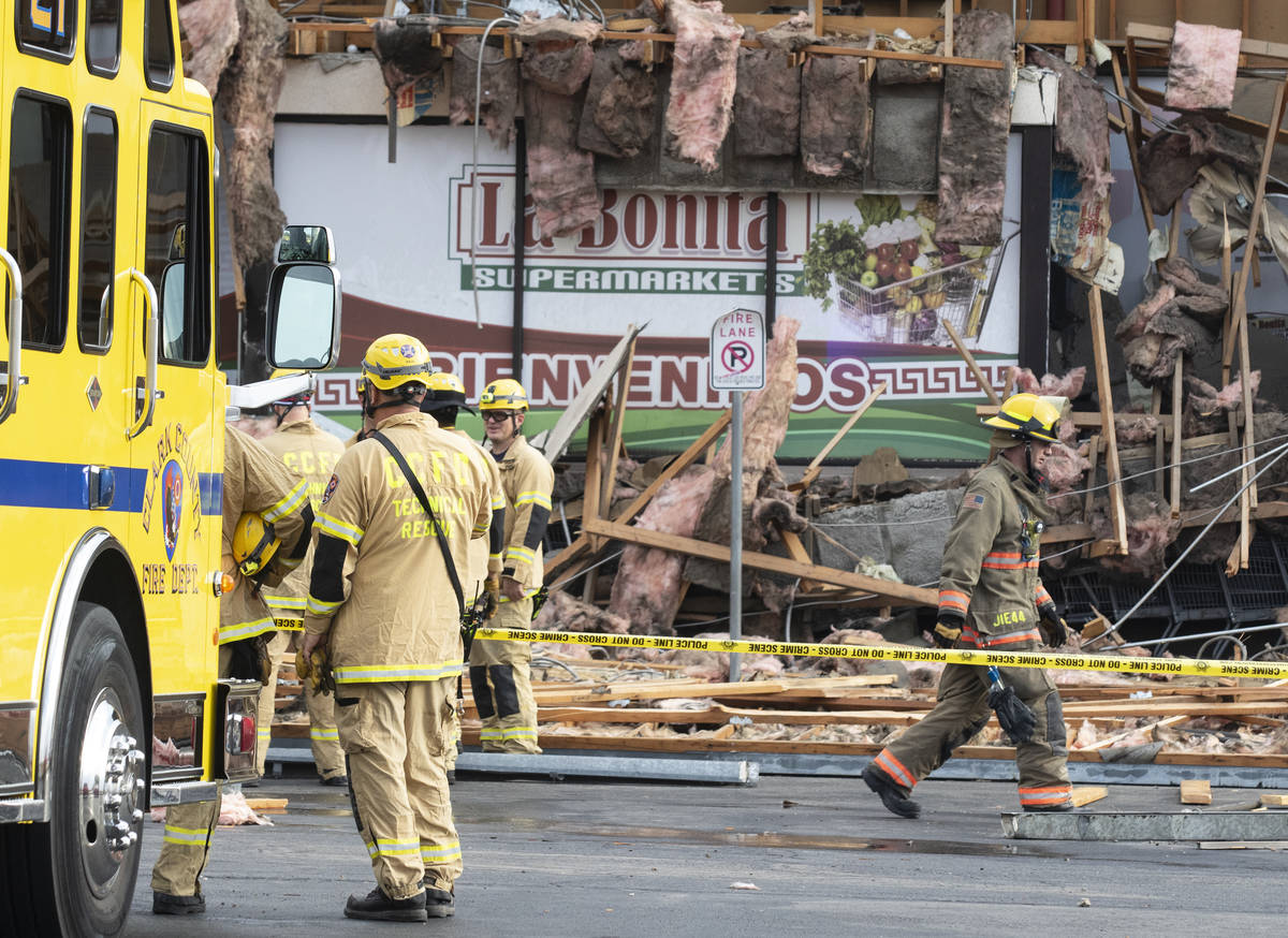 The Clark County firefighters work through debris after a portion of La Bonita supermarket coll ...