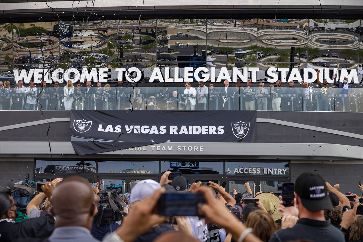Invited dignitaries join Raiders owner Mark Davis before fans during the official ribbon cuttin ...