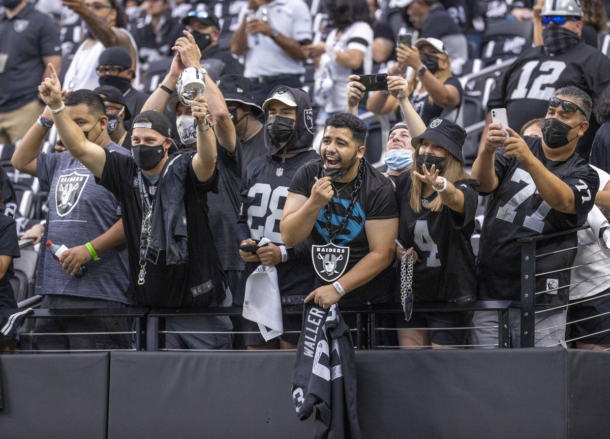 Fans yell for players before the Raiders home opening pre-season NFL football game versus the S ...
