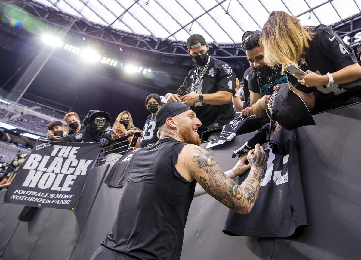 Raiders defensive end Maxx Crosby (98) signs autographs for fans before the Raiders home openin ...