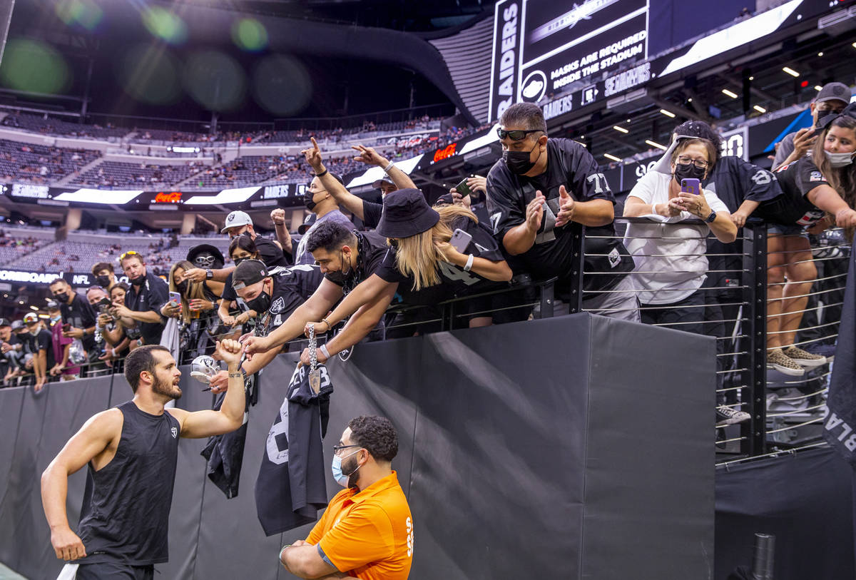 Raiders quarterback Derek Carr (4) greets fans on the field before the Raiders home opening pre ...