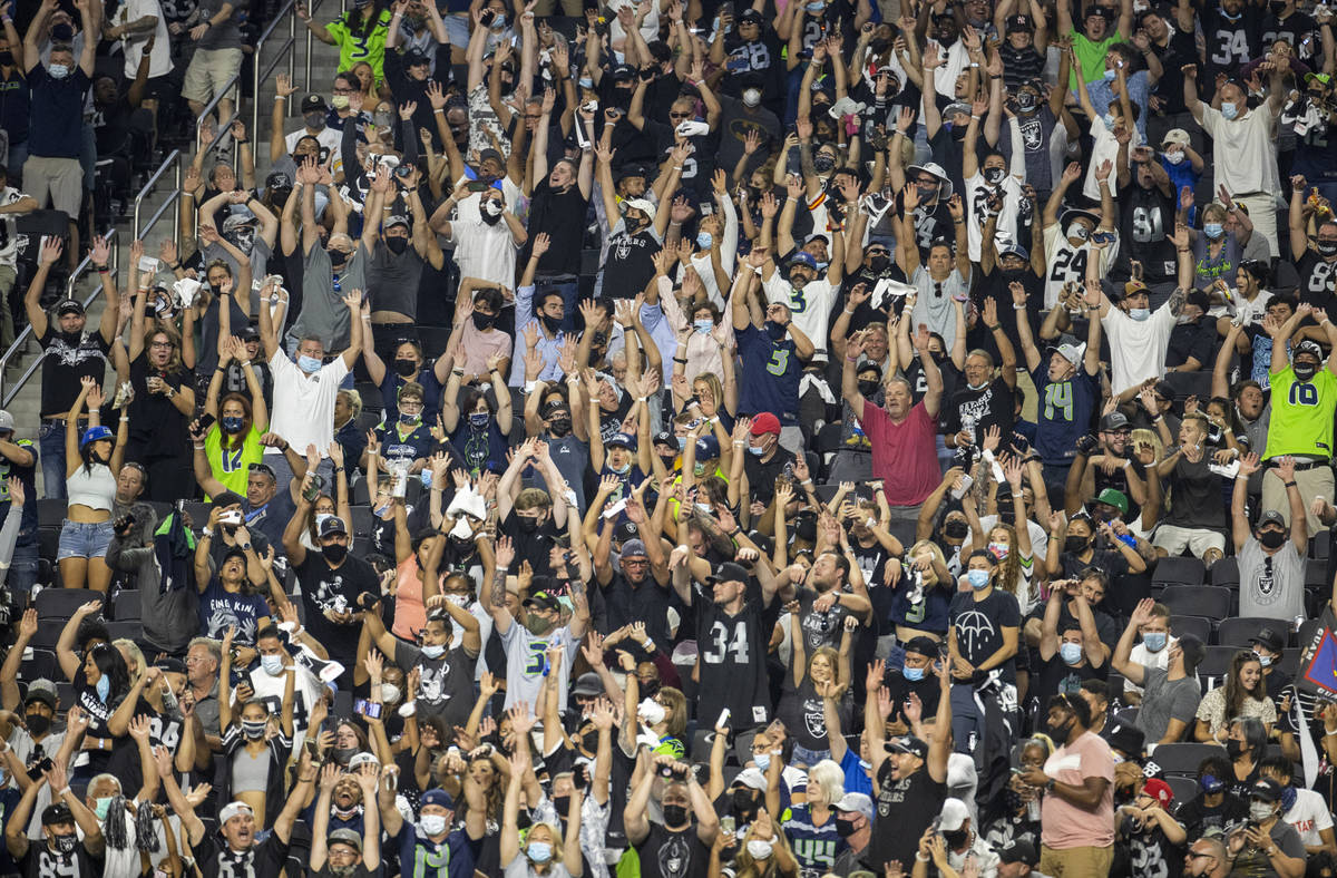 Fans do Òthe waveÓ during the third quarter of the Raiders home opening pre-season NF ...