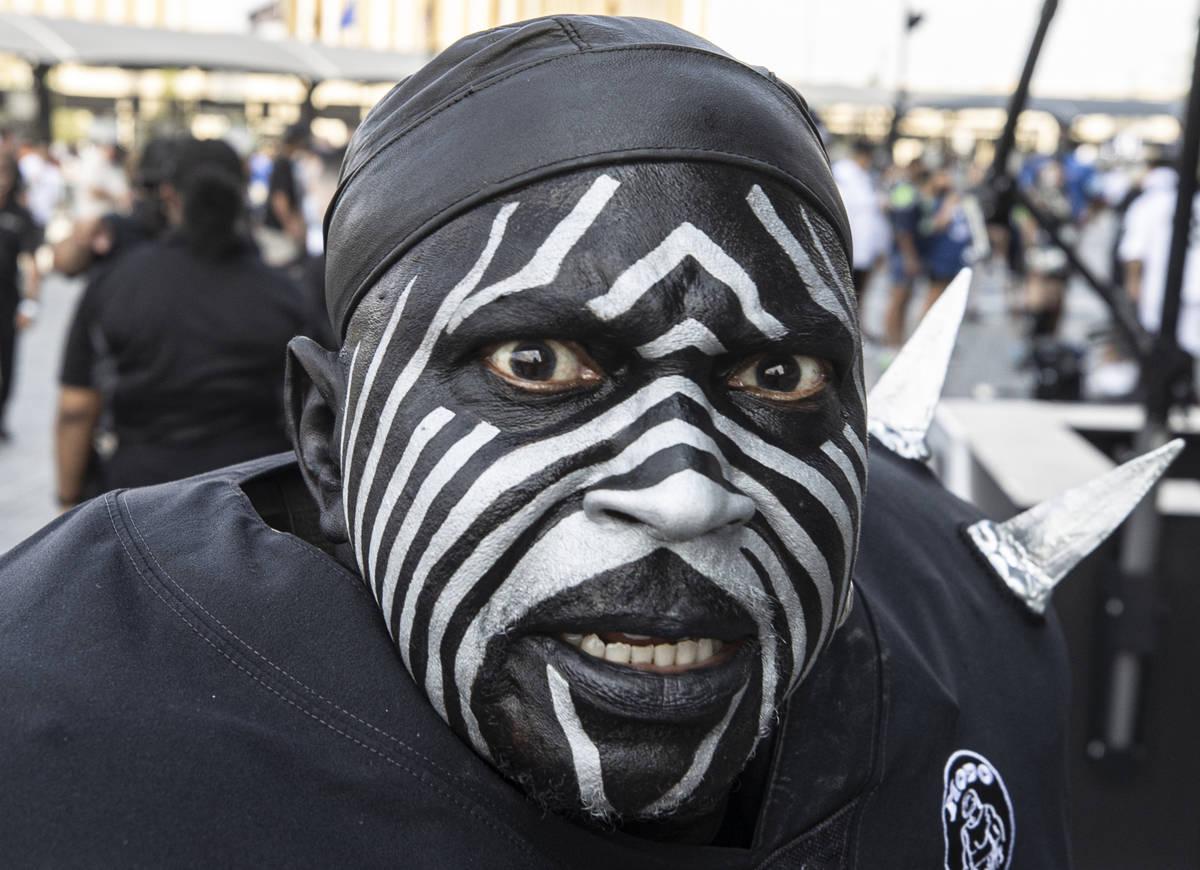 "Raiders super fan ""Violator"" makes his way to Allegiant Stadium before the start ..."