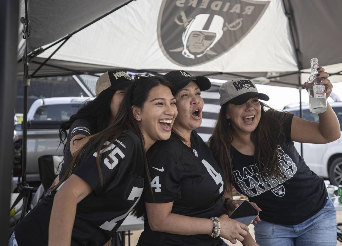 Raiders fans Isabella Luna, left, Carmen Tellez and Lisette Dominguez tailgate outside Allegian ...