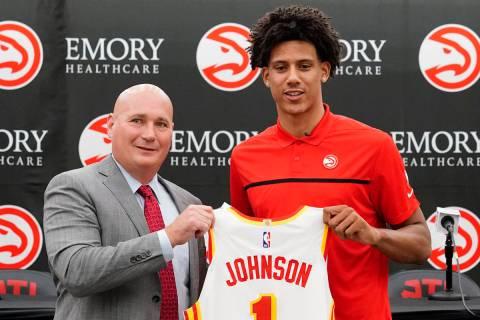 Atlanta Hawks NBA basketball draft pick Jalen Johnson, right, and Hawks general manger Travis S ...