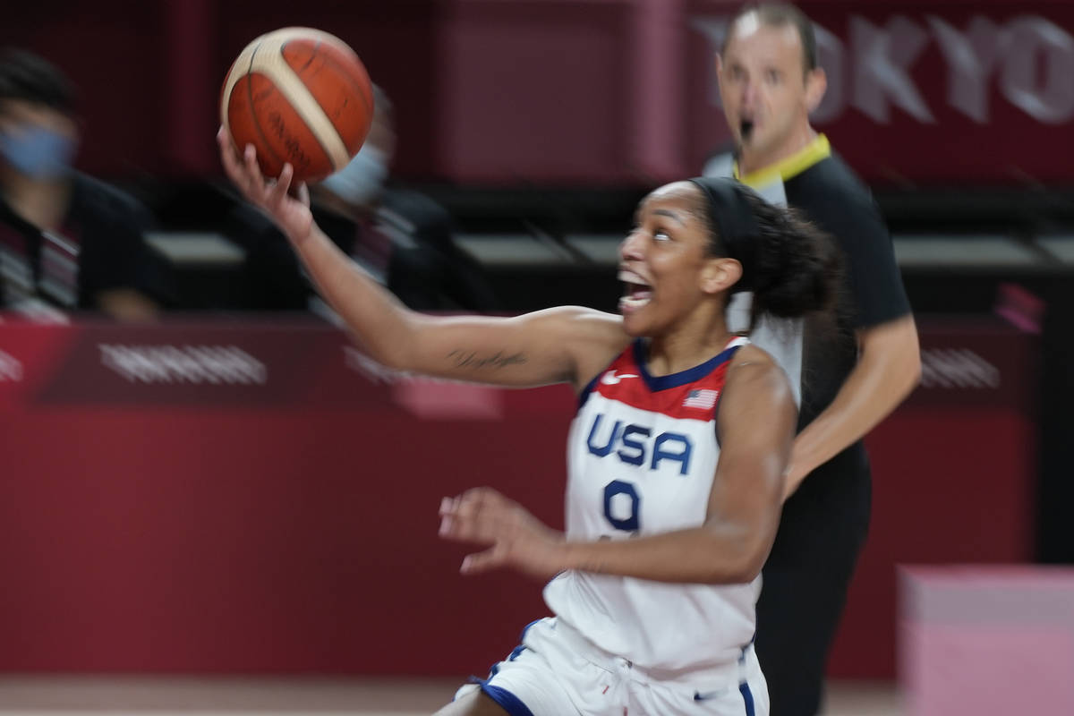United States' A'Ja Wilson (9) drives to the basket during women's basketball gold medal game a ...