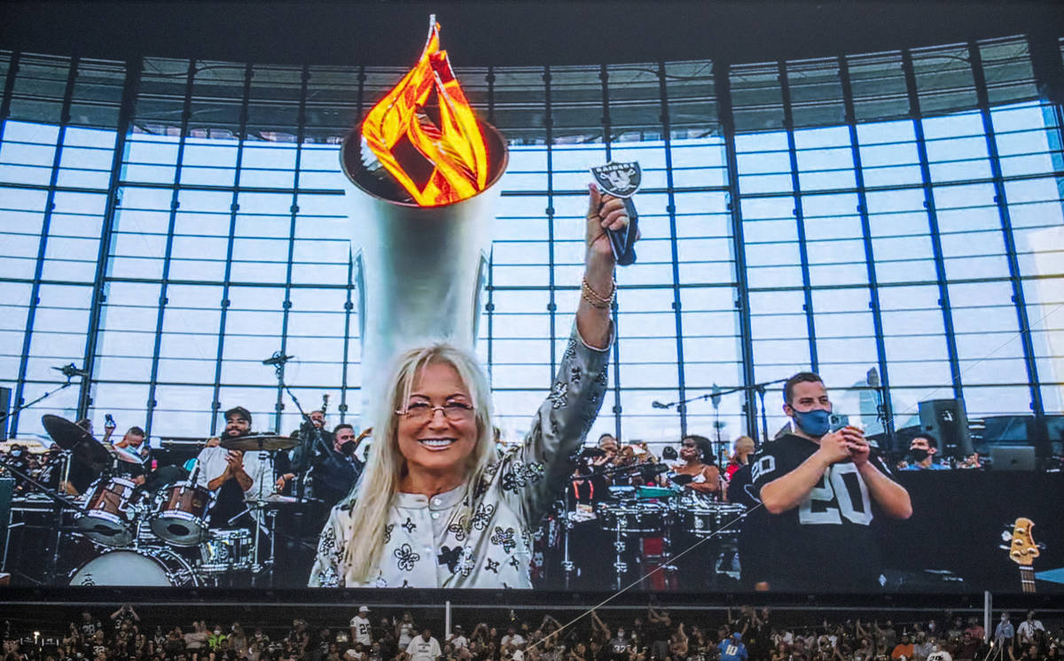 Dr. Miriam Adelson lights the Al Davis Memorial Torch Flame before the Raiders home opening pre ...
