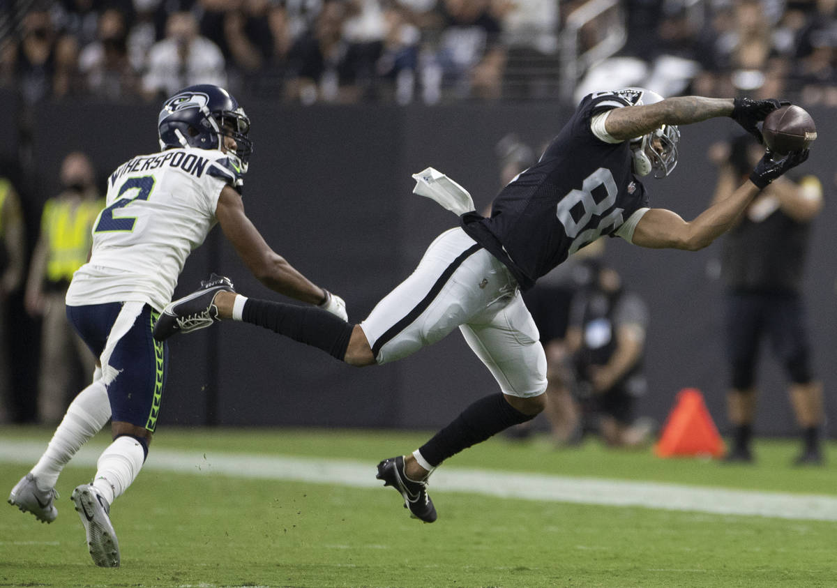 Raiders wide receiver Marcell Ateman (88) makes a diving catch past Seattle Seahawks cornerback ...