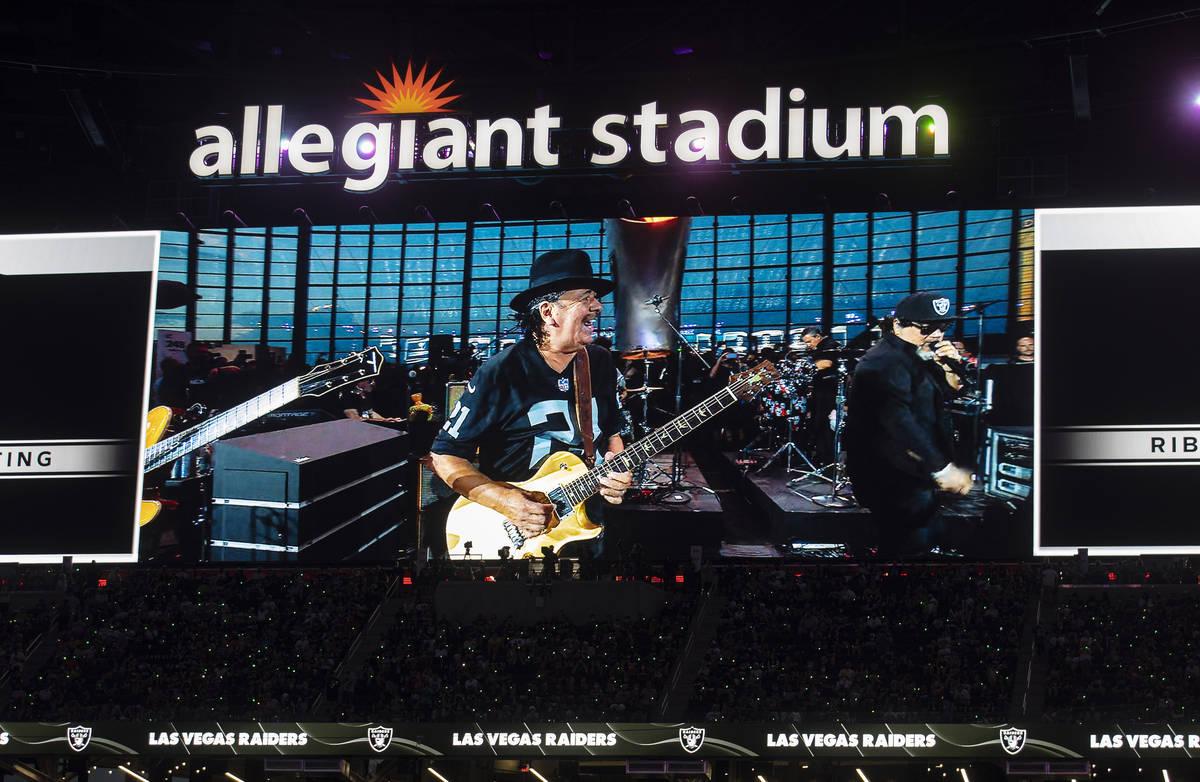 Musician and Las Vegas resident Carlos Santana performs at halftime during an NFL preseason foo ...