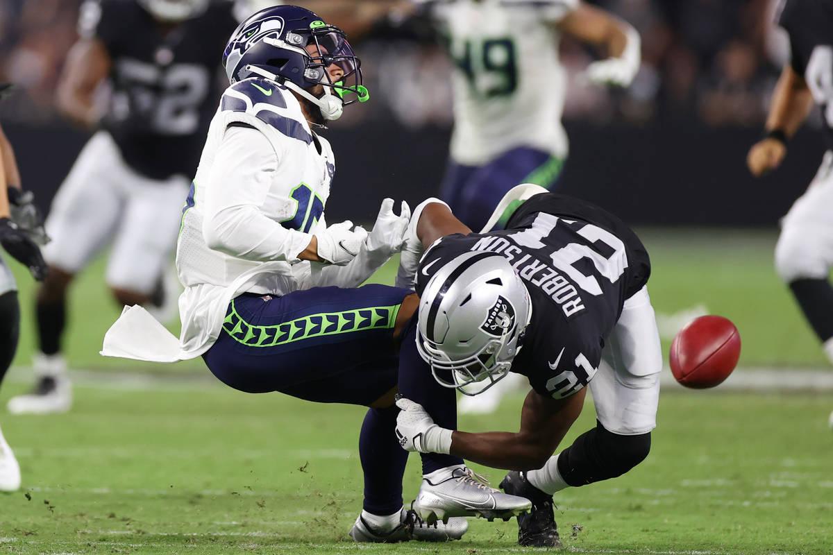 Seattle Seahawks wide receiver John Ursua (15) is tackled by Las Vegas Raiders cornerback Amik ...