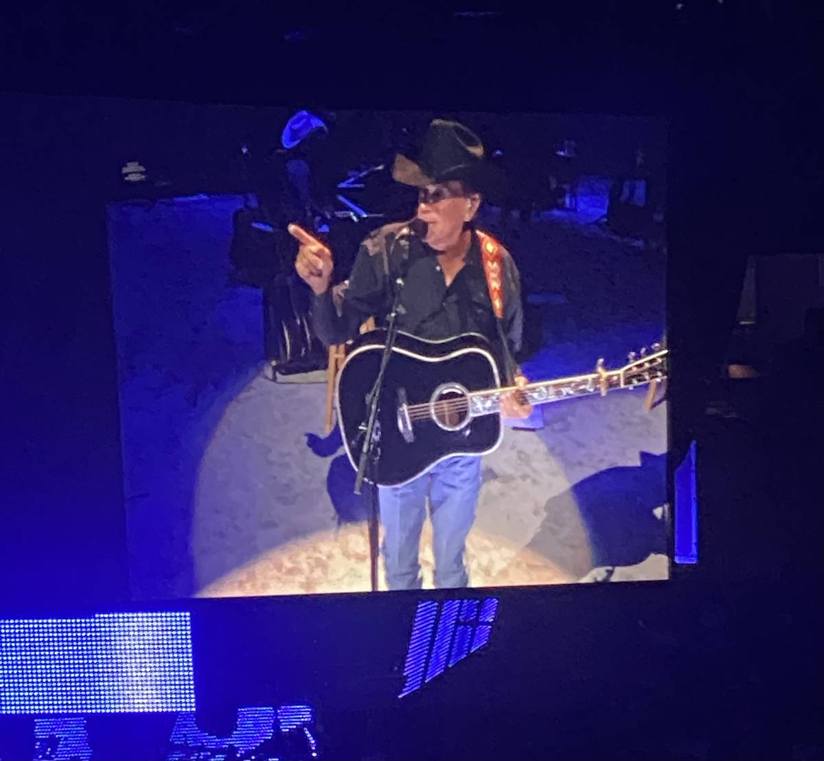 George Strait is shown on the big screen in his return to T-Mobile Arena on Friday, Aug. 13, 20 ...