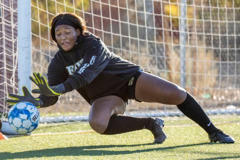 Goalkeeper Jordan Brown defends the net during a girlÕs soccer team practice at Faith Luth ...