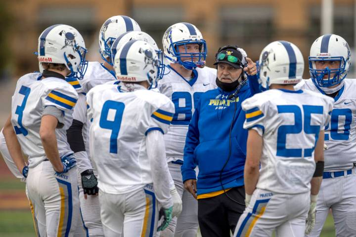Moapa Valley football coach Brent Lewis talks to his team during a game against Faith Lutheran ...