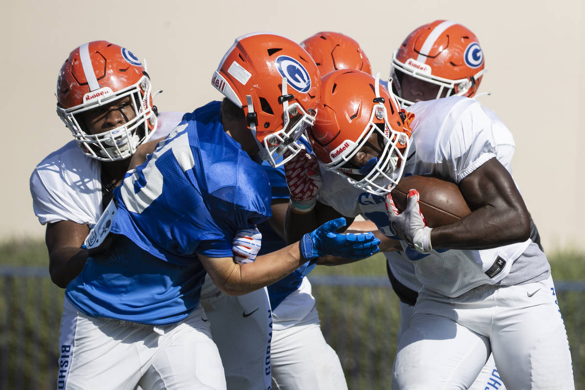 Bishop Gorman High SchoolÕs running back/linebacker Will Stallings, right, avoids a tackle ...