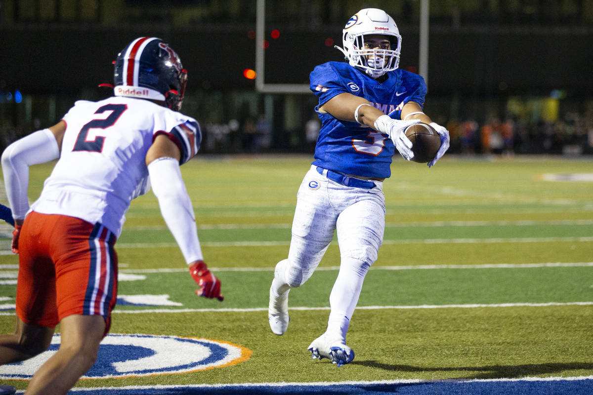 Bishop Gorman's Cam'ron Barfield (3) runs for a touchdown during the second quarter of a footb ...
