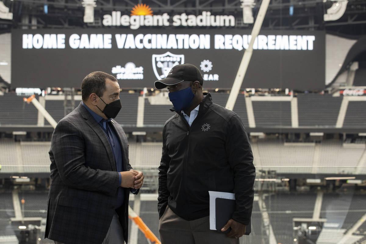 Las Vegas Raiders president Dan Ventrelle, left, and CLEAR'S senior vice president of sports an ...